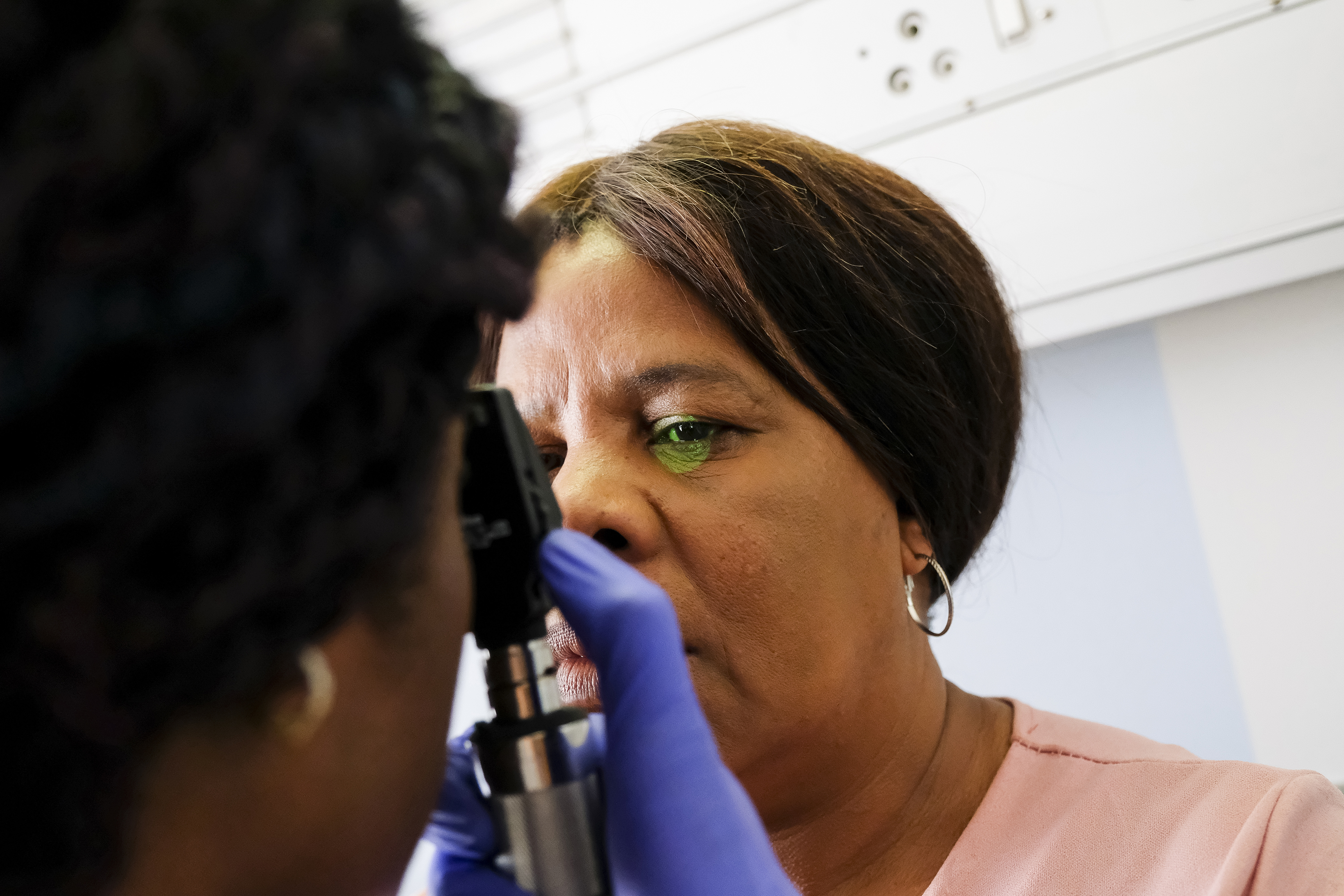 photo, woman receiving an eye exam