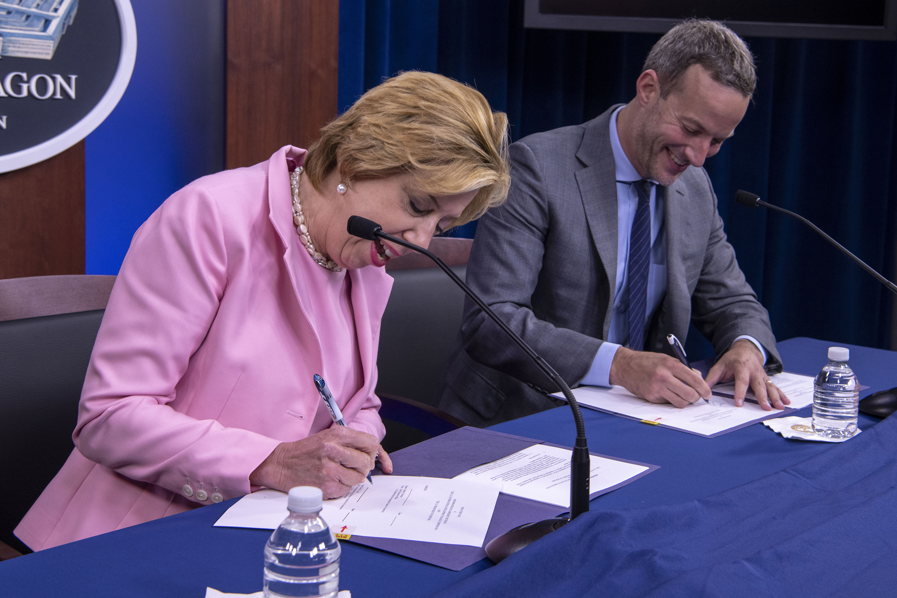 photo, DFC CEO Adam Boehler and DoD Under Secretary for Acquisition and Sustainment Ellen M. Lord sign Memorandum of Agreement at the Pentagon