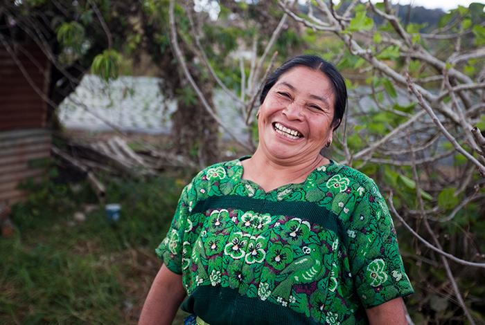photo, Latina woman wearing green dress smiling, Kiva, DFC, USDFC, OPIC, US International Development Finance Corporation