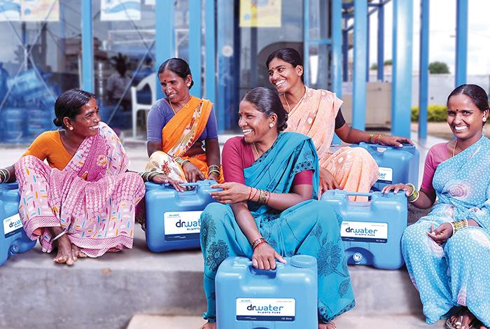 photo, WaterHealth, five Indian women with water jugs, DFC, OPIC, US International Development Finance Corporation
