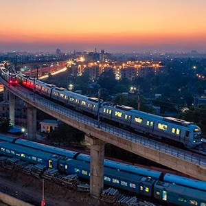 photo, trains in industrial section of a large city, Blue Dot Network