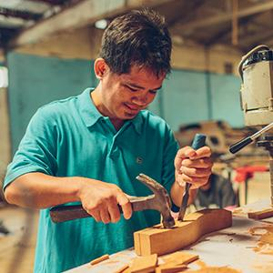 photo, man doing woodwork